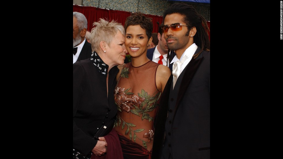 "Halle Berry arrives with her mother Judy and her then-husband Eric Benet at the 74th Annual Academy Awards  in Hollywood, California, on March 24, 2002. Berry would win Best Actress for her role in ""Monster's Ball."""