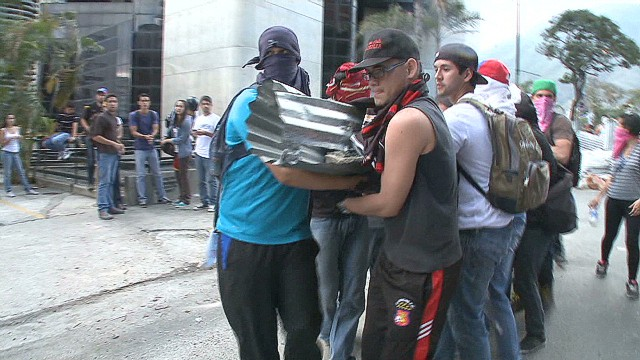 Protesters organize against riot police
