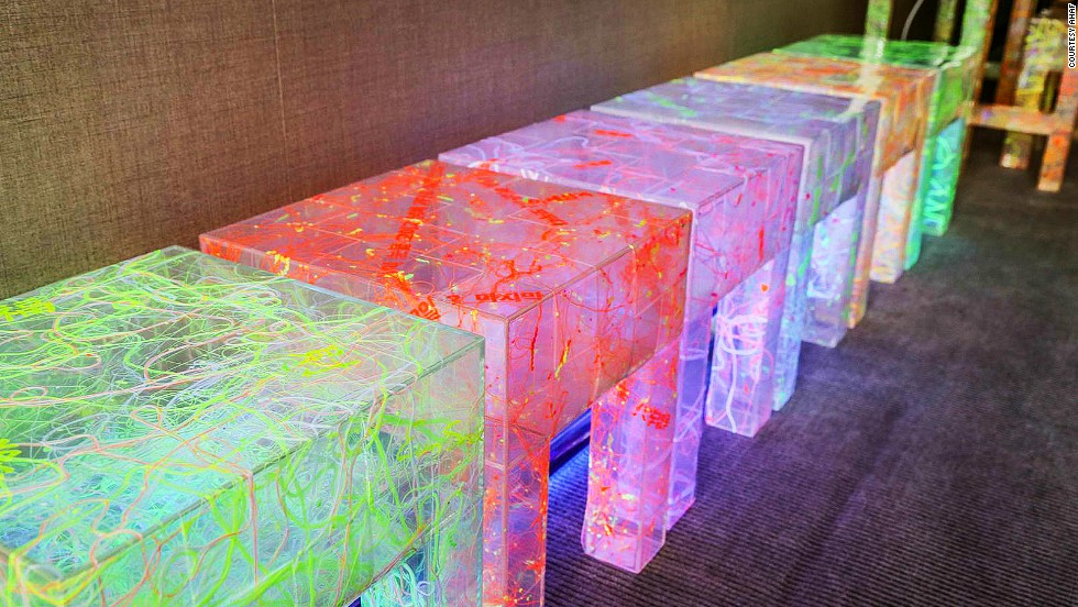 Artist Lee Eunsook feels that modern society hinders communication and creates stress. Her benches and chairs are made of hundreds of small polyester chairs and illuminated with black light.