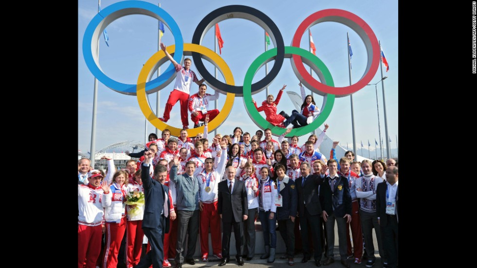 Putin poses for a photo with Russian Olympic athletes in Sochi, Russia, in February 2014. Russia hosted the Winter Olympic Games and won the most medals.