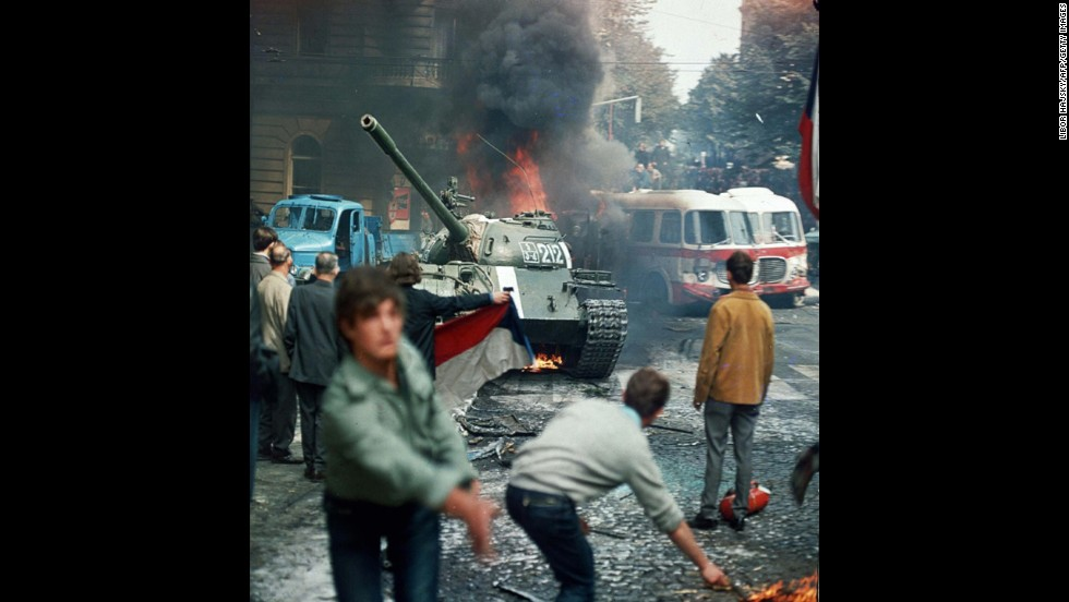 "On January 5, 1968, reformer Alexander Dubcek became general secretary of the Communist Party in Czechoslovakia, pledging the ""widest possible democratizations"" as the Prague Spring movement swept across the country. Soviet and Warsaw Pact leaders sent an invasion force of 650,000 troops in August. Dubcek was arrested and hard-liners were restored to power. Here, residents carrying a Czechoslovak flag and throwing burning torches attempt to stop a Soviet tank in Prague on August 21, 1968."