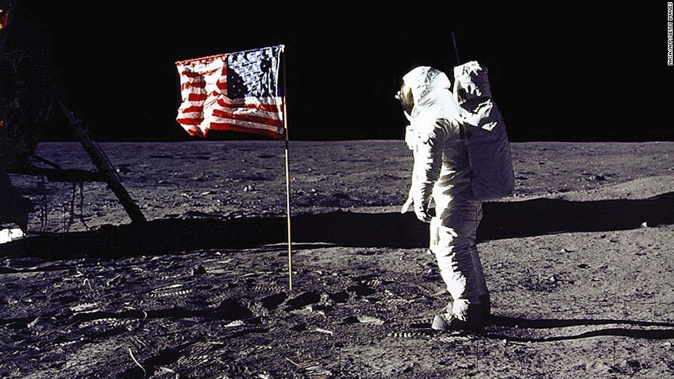 "Apollo 11 astronaut Edwin E. ""Buzz"" Aldrin Jr. salutes the U.S. flag on the lunar surface on July 20, 1969. Aldrin and mission commander Neil Armstrong became the first humans to walk on the moon. Their mission was considered an American victory in the Cold War and subsequent space race, meeting President Kennedy's goal of ""landing a man on the moon and returning him safely"" before the end of the decade."