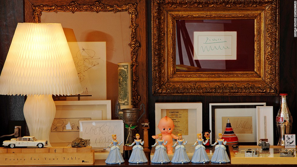 "<em>Marcio Kogan, São Paulo</em><br /><br />Kogan has filled his home with knick-knacks he has collected around the world, including ornaments, photos, and tourist souvenirs. ""Kogan remembers the story of each one of them and how they got here,"" Molteni says. ""It creates a special place."""