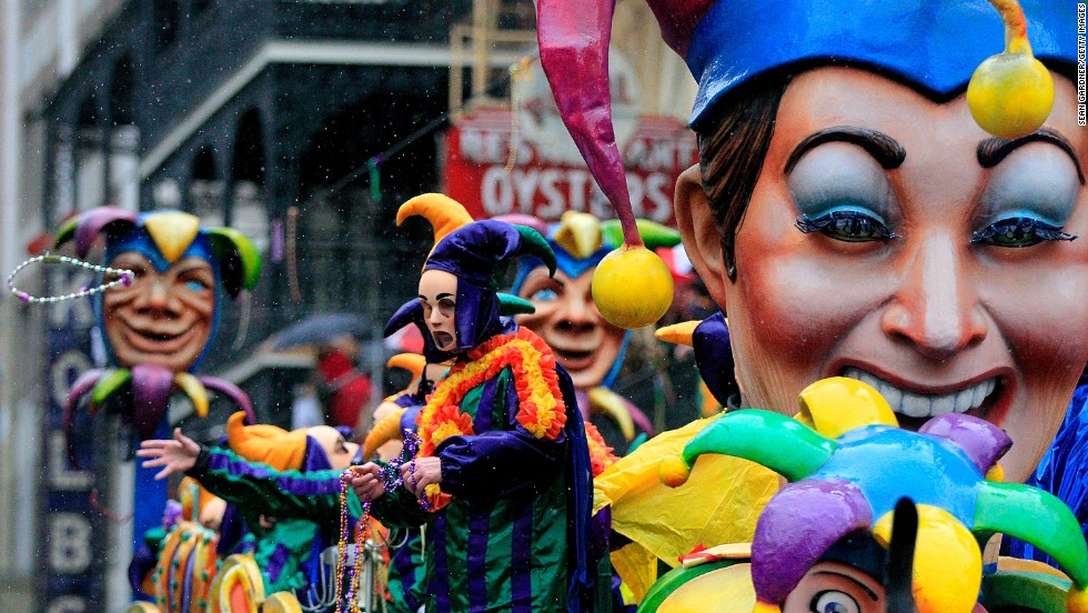 The Rex parade makes its way down St. Charles Avenue despite the rain during Mardi Gras celebrations in New Orleans on Tuesday, March 4.