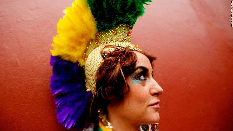 A reveler leans against a wall in the French Quarter of New Orleans.