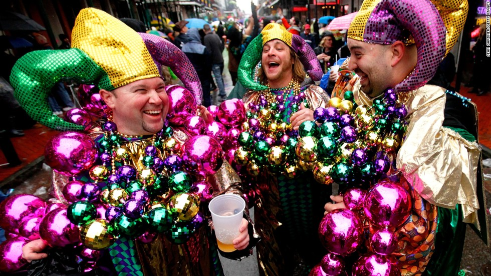 Men dressed up for Mardi Gras party in the streets of New Orleans.