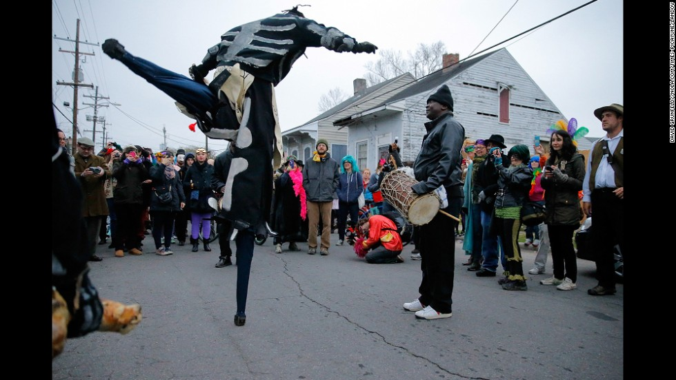 Members of the North Side Skull and Bones dance in the Treme neighborhood of New Orleans, waking up residents to start off Mardi Gras. The tradition dates back to 1819.
