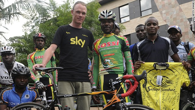 Chris Froome learned to ride in Kenya, where he grew up, after being taught by mentor David Kinjah (center).