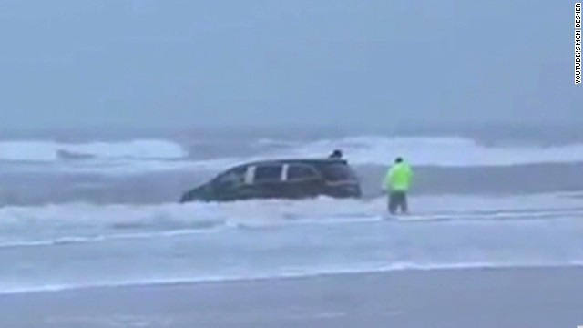 Witness: Mom drove van, kids into waves
