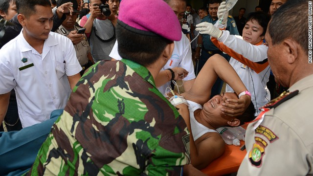 A man injured in an Indonesian navy ammunition blast is brought to a navy hospital in Jakarta on March 5, 2014.