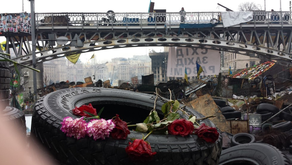"KIEV, UKRAINE:  Portraits of people killed during clashes with riot police are left with candles and flowers at Kiev's Independence Square on March 6.  Photo by CNN's Michael Holmes.  Follow Michael on Instagram at <a href=""http://instagram.com/holmescnn"" target=""_blank"">instagram.com/holmescnn</a>."