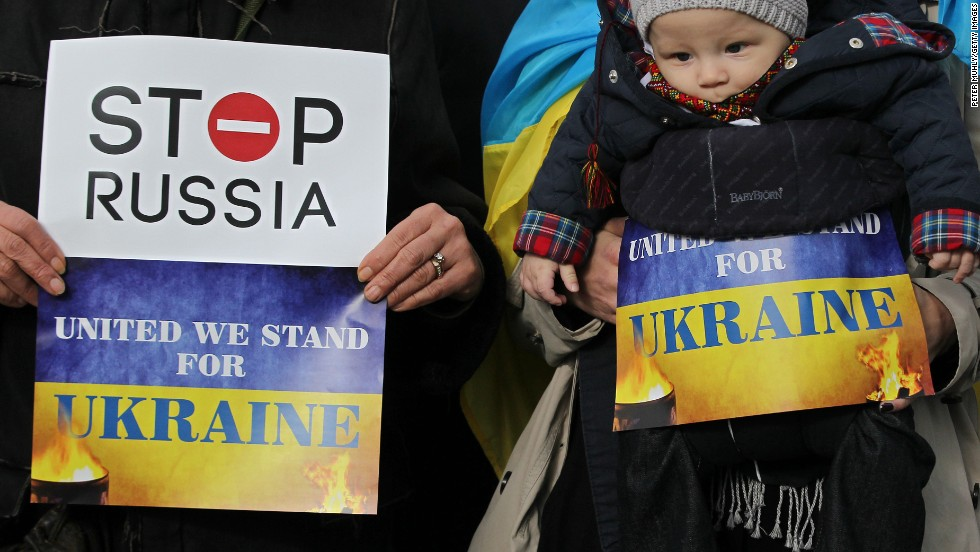 Pro-Ukrainian supporters demonstrate in Dublin where delegates have been arriving for the European Peoples Party conference.