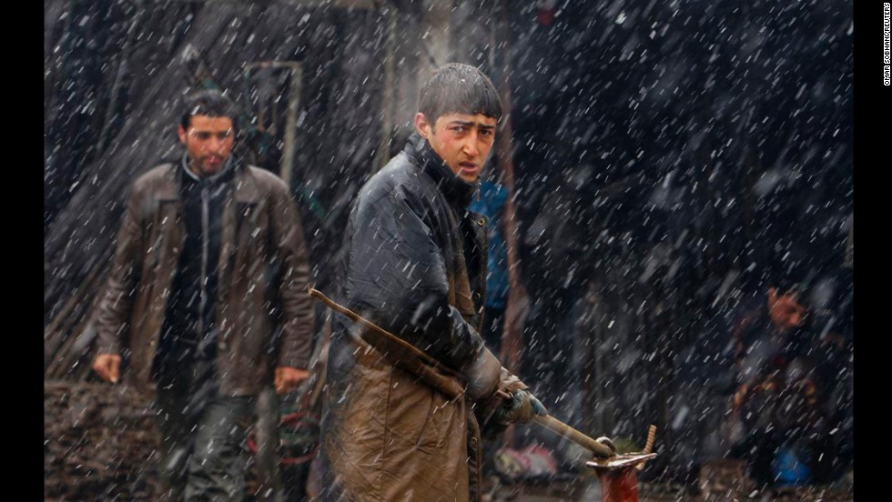 Young laborers work along a street in Kabul, Afghanistan, on Monday, March 3.