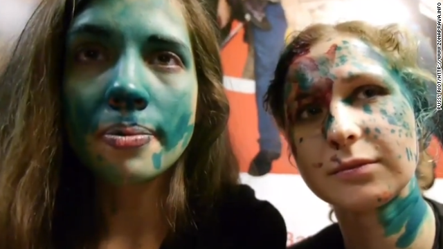 A screen capture from a Youtube video posted by Russian punk band Pussy Riot shows members' faces smeared in paint after an attack in a McDonald's.