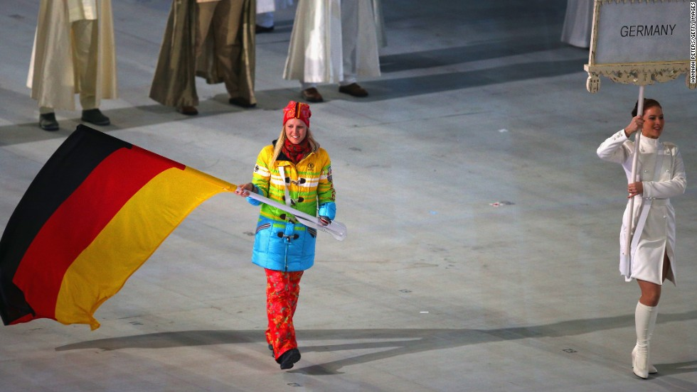 Skier Andrea Rothfuss carries the flag for Germany.