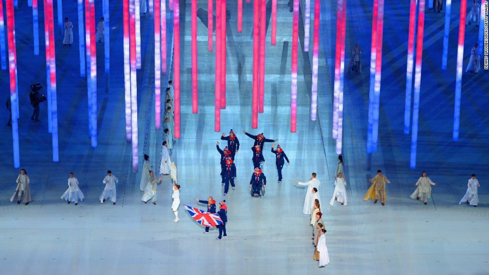 Skier Millie Knight leads Great Britain into the stadium.