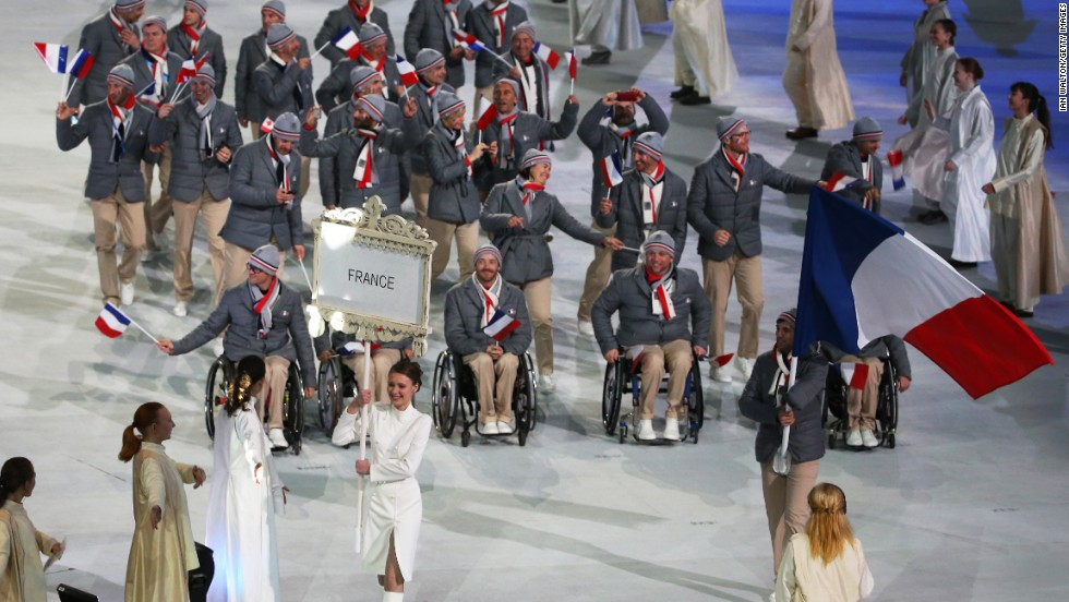 France enters the stadium led by skier and flag bearer Vincent Gauthier-Manuel.