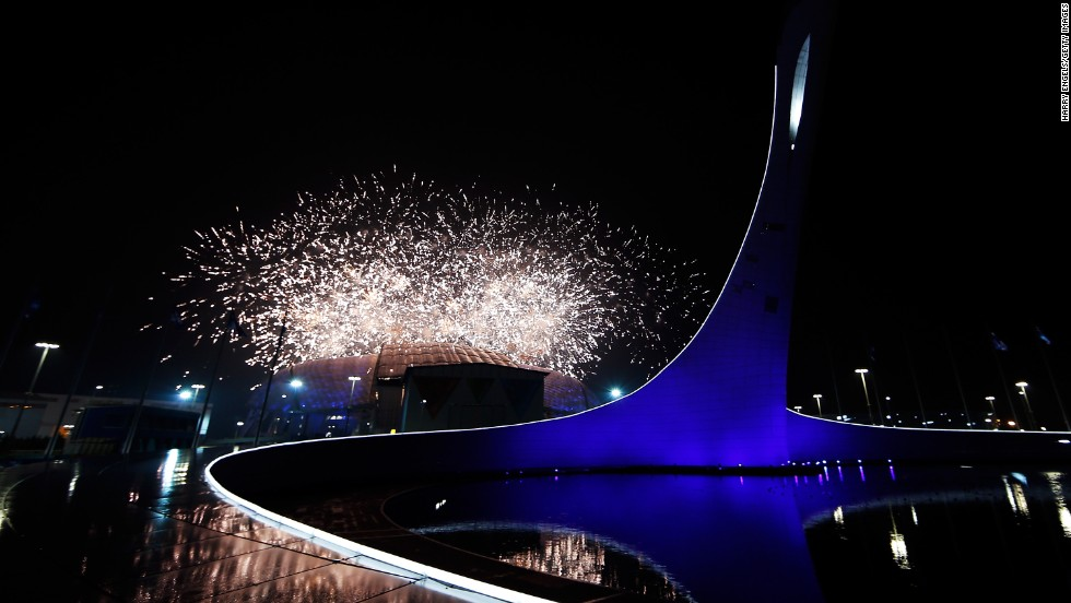 Fireworks explode over the stadium at the start of the event.