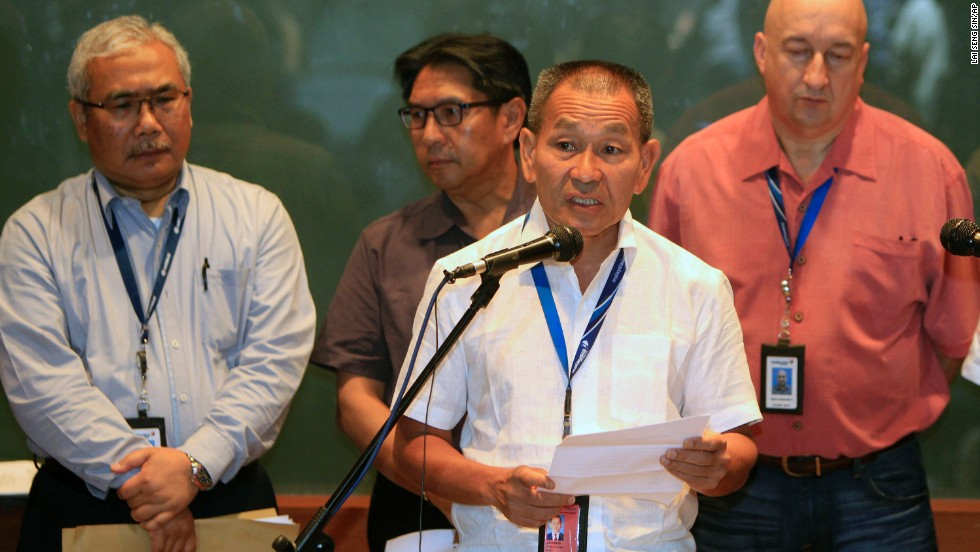 "Malaysia Airlines Group CEO Ahmad Juahari Yahya, front, speaks during a news conference at a hotel in Sepang on March 8, 2014. ""We deeply regret that we have lost all contacts"" with the jet, he said."