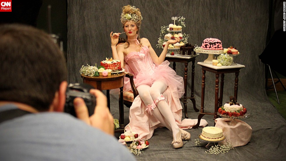 It's good to be queen? Here, a behind-the-scenes shot shows model Camille Dauchez as Marie Antoinette, enveloped in dessert.
