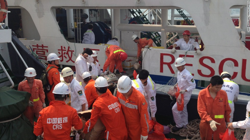 Members of a Chinese emergency response team board a rescue vessel at the port of Sanya in China's Hainan province on March 9, 2014.