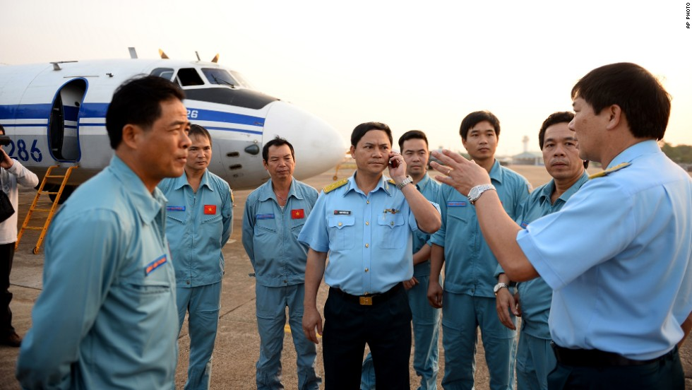 Vietnamese air force crew stand in front of a plane at Tan Son Nhat airport in Ho Chi Minh City on March 9, 2014, before heading out to the area between Vietnam and Malaysia where the airliner vanished.