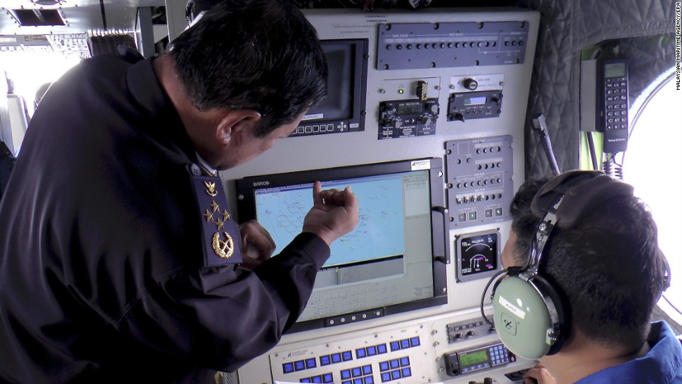 A handout picture provided by the Malaysian Maritime Enforcement Agency shows personnel checking a radar screen during search-and-rescue operations March 9, 2014.