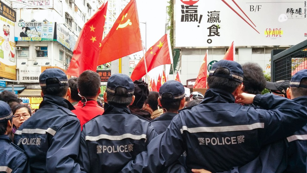 Police formed human walls to restrain the protest, which was rowdy at times.