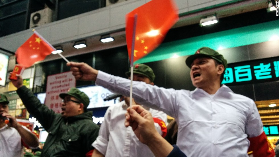 "In a satirical ""Communist rally"" aimed at mainland Chinese shoppers, about 100 Hong Kongers marched through the city on Sunday wearing Maoist costumes, yelling ""love your country, buy Chinese products!"""