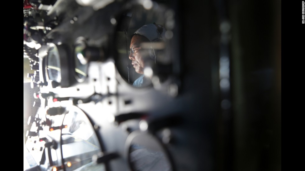 Vietnam air force Col. Le Huu Hanh is reflected on the navigation control panel of a plane that is part of the search operation over the South China Sea on March 10, 2014.