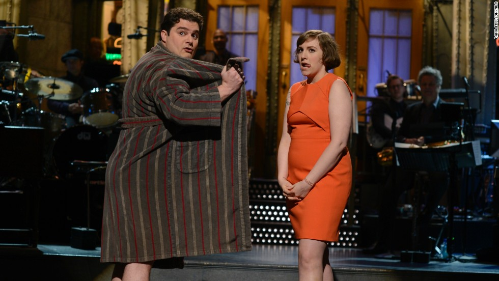 "She's also been on other TV shows. In 2014, she hosted ""Saturday Night Live."" Here, she shares a moment with Bobby Moynihan."