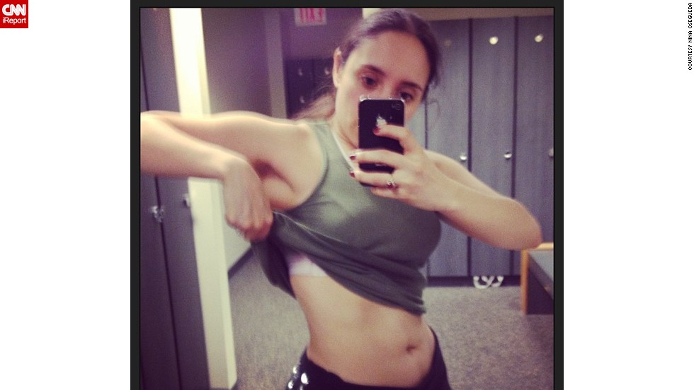 "Osegueda works out three to four times a week. Here she is in 2013, at the gym, ""showing off my 'ab sprouts'."""