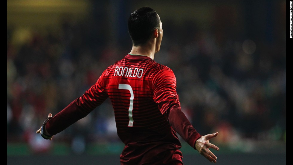 Portugal's Cristiano Ronaldo celebrates after scoring against Cameroon during a soccer match Wednesday, March 5, in Leiria, Portugal.
