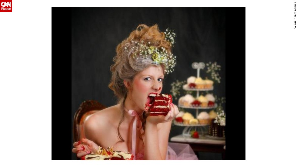 """Marie Antoinette"" -- An un-ladylike image of Marie Antoinette shows her biting into a scarlet slice of red velvet."