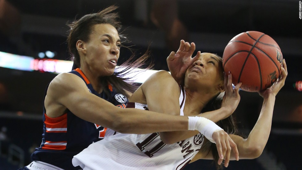 Texas A&M guard Curtyce Knox, right, is fouled by Auburn's Tyrese Tanner in the quarterfinals of the SEC women's basketball tournament on Friday, March 7.