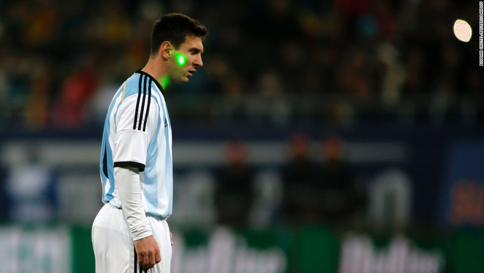A fan uses a laser pointer in an attempt to distract Argentina's Lionel Messi during a soccer match Wednesday, March 5, in Bucharest, Romania.