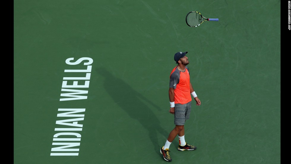 Steve Johnson bounces his tennis racket Friday, March 7, after losing a point to Roberto Bautista Agut during the BNP Paribas Open in Indian Wells, California.