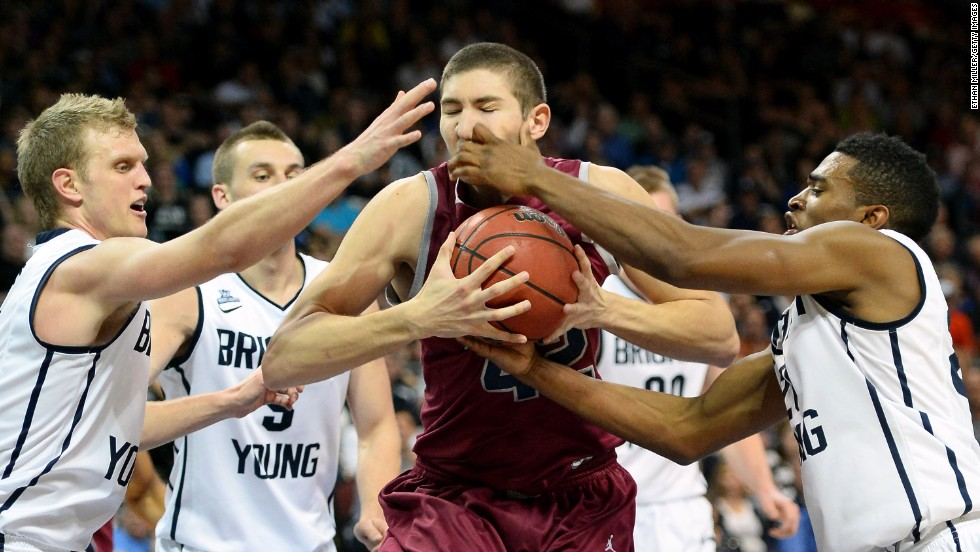 Loyola Marymount's Marin Mornar is swarmed by BYU defenders during the West Coast Conference basketball tournament Saturday, March 8, in Las Vegas.
