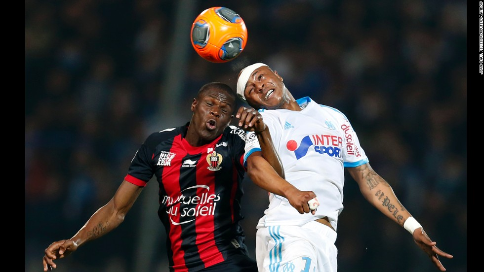 Marseille's Andre Ayew, right, collides with Nice's Romain Genevois as he heads the ball during a Ligue 1 soccer match Friday, March 7, in Marseille, France.