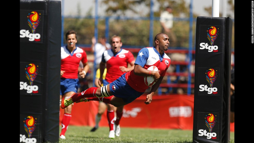 "Leonardo Montoya of Chile jumps to score at try Saturday, March 8, during rugby qualifiers at the South American Games in Santiago, Chile. <a href=""http://www.cnn.com/2014/03/04/worldsport/gallery/what-a-shot-0304/index.html"">See 38 amazing sports photos from last week.</a>"