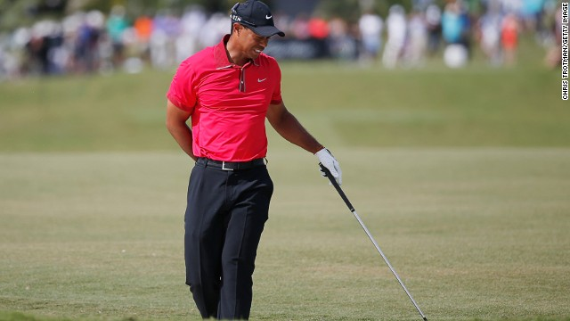 Tiger Woods grimaces during the final round of he WGC Cadillac Championship on Sunday.
