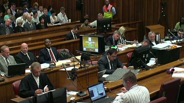 Pistorius vomits and weeps in court