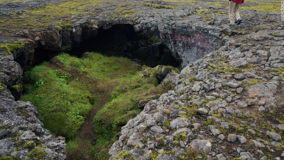 "The rocks and small underground caves marking the scarred landscape around Thrihnukagigur are associated with huldufólk, Iceland's ""hidden people."""