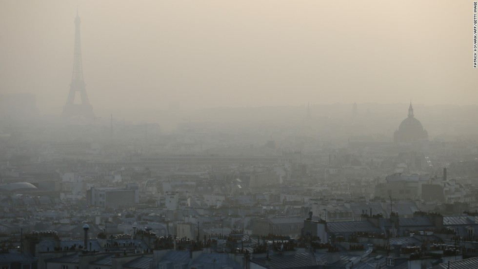 "MARCH 12 - PARIS, FRANCE: The Eiffel tower and the roofs of Paris are only just visible through a haze of pollution. City officials said people prone to health problems, children and seniors should remain indoors as three environmental organizations filed a lawsuit against the city for ""<a href=""http://edition.cnn.com/2013/10/17/health/geneva-air-pollution-carcinogenic-who/"">endangering the lives of others</a>"" by their lack of response."