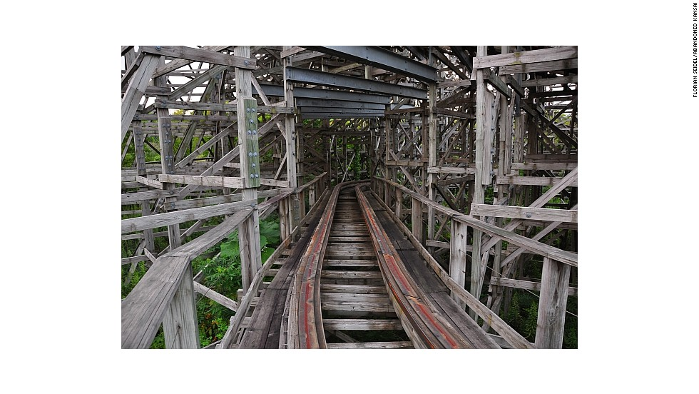 Given the potential dangers of climbing around abandoned amusement park structures, such as this roller coaster, security guards are now stationed at Nara Dreamland. Seidel says the park, an obvious ripoff of Disneyland, couldn't compete with the arrival of Universal Studios Japan in 2001, which is why it closed five years later.