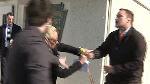 mxp woman smacks reporter with purse_00002606.jpg