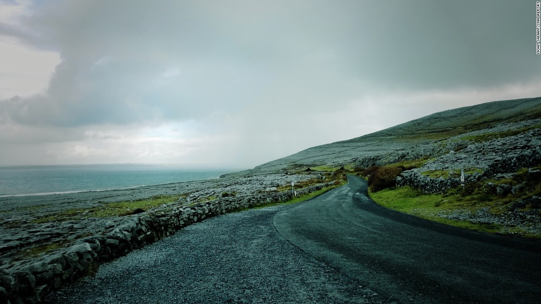 An empty road winds along the Atlantic Coast near Doolin, in County Clare.