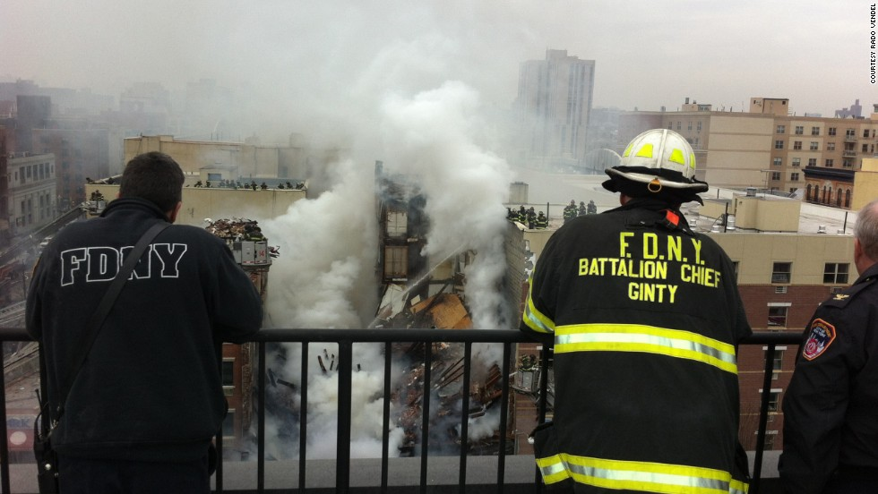 Firefighters observe rescue efforts after the explosion.