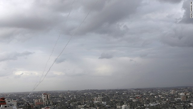 A trail of smoke from rockets fired by Palestinian militants from Gaza toward Israel is seen above Gaza City on Wednesday.