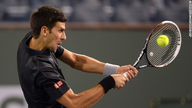 Serbia's Novak Djokovic hits a return against Croatia's Marin Cilic on Wednesday.